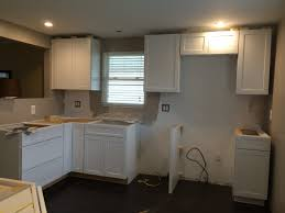 installing kitchen cabinets for a sizable cabinet design in the