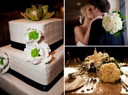 tier square white wedding cake adorned with black ribbon and white