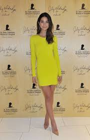 lily aldridge wearing yellow bodycon dress tan leather pumps