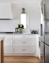 white kitchen cabinets with hexagon backsplash everything you need to about hexagon tile julie blanner