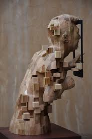these pixelated sculptures that look like computer glitches are