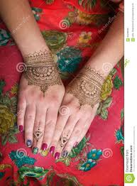 two hands with henna tattoos mehendi designs stock photo image