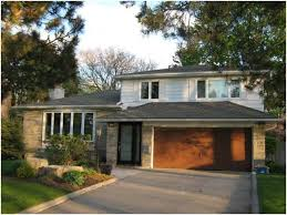 split level house exterior not crazy about the garage door but