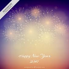 blur background of happy new year 2017 with fireworks vector