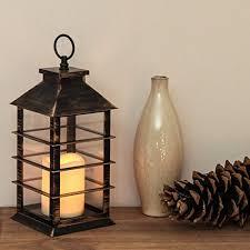 lanterne effet métal noir doré 31cm avec bougie led intérieur