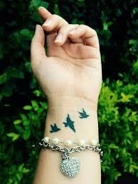 25 ide terbaik bird wrist tattoos di pinterest tato kecil