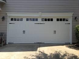 steel carriage garage doors steel raised panel carriage house garage door with windows and