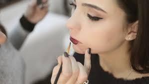 makeup professional professional makeup artist paints a model makeup