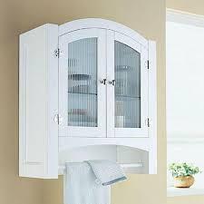 bathroom mount medicine cabinet with white wood frame above