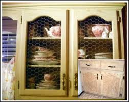 how to put chicken wire on cabinet doors makeover a cabinet door with chicken wire panels