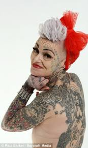 mother who covered 80 of her body with tattoos after splitting