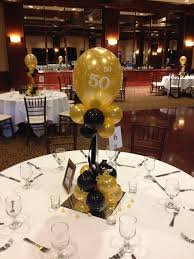 black and gold centerpieces black and gold balloon centerpieces for a 50th birthday or