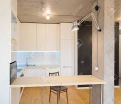 modern and stylish white kitchen concrete ceiling wooden floor