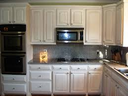 granite countertop grey lacquer kitchen cabinets slate subway