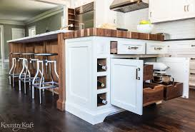 stained kitchen island with pull out drawers and wine rack