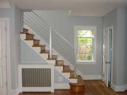 Stairs With Laminate Flooring Brown Wooden Staircase With White String On Laminate Flooring Plus