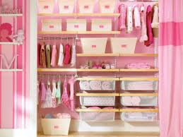 interior pink baby closet organizer with cloth hanging areas