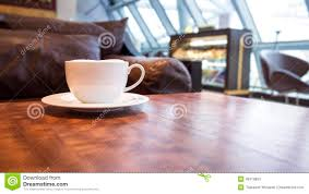 coffee shop cafe interior with coffee on table stock photo image