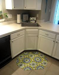 white wooden corner kitchen cabinet with granite countertop and