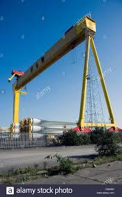 mobile gantry crane towers above newly fabricated wind turbine