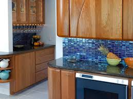 blue tiles kitchen backsplash with wooden cabinets and black