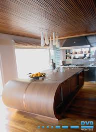 walnut curved kitchen island unit with copper inlays slatted