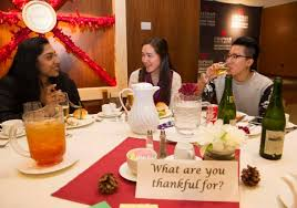 photos students gather in argyros forum for annual thanksgiving
