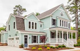 attractive modern farmhouse with l shaped porch 30082rt country at