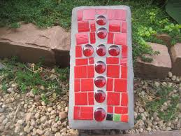 backyard tiles cross of red brick with red stained glass