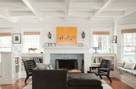 living room yellow wall art with french style fireplace also