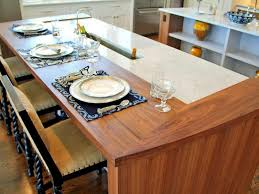 wooden kitchen table with chairs have some plates and spoon