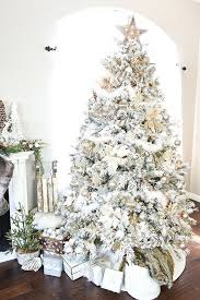 silver and pearl ornaments highlight the tree decor and make it