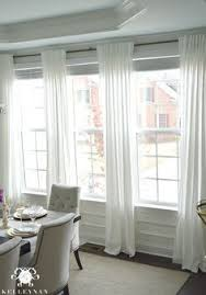 smith and noble traditional window treatment idea for living room