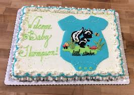 baby shower sheet cake with piped skunk and onesie u2014 trefzger u0027s bakery