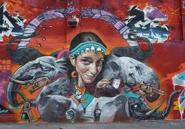 belin s funny photo realistic graffiti murals bring humor to the a funny caricature of a young woman looks out in a cheeky way from this fusion