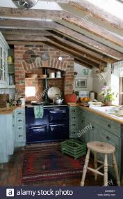 gray blue kitchen blue aga set in brick recess in cottage kitchen with pale gray
