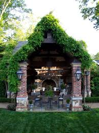 brick pavilion with weathered gate and ivy on roof peaks hgtv