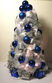 silver blue and white tree made with ribbon it also