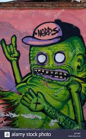 green monster stock photos green monster stock images alamy wall mural depicting a green monster along a street in the spanish colonial city of santiago