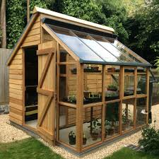 Backyard Green House by Building A Greenhouse Can Be Inexpensive If You Use Recycled Doors