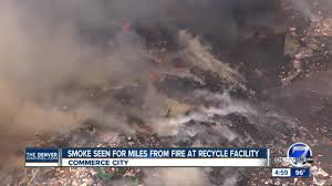 Wildfire Smoke In Denver by Trash Piles At Waste Management Facility In Adams County On Fire