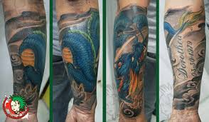 collection of 25 family anchor in blue wave tattoos on half sleeve