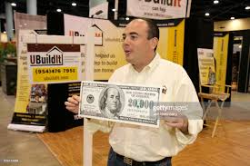 home design miami beach convention center a man holding a giant 20 000 bill at the home design and remodeling