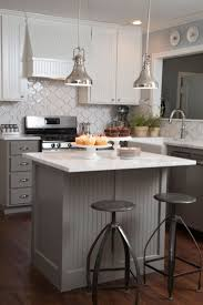 islands in small kitchens as seen on hgtv s fixer upper love the gray beadboard on the