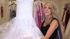 what is the thing that goes under wedding dresses to make them