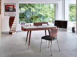 luxury interior design luxury furniture how to spend it the danish retro desk shown in walnut has a corian top and is also available in