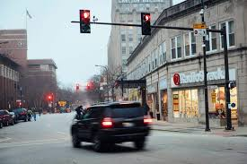 what is considered running a red light chicago changes red light camera program following northwestern study
