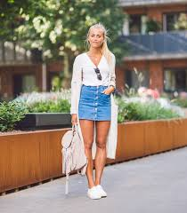 denim skirts jannie deler is wearing this summers most worn item the button