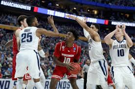 wisconsin upsets ncaa defending champions villanova new