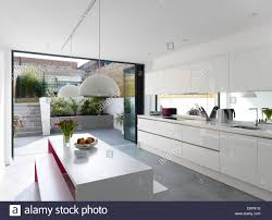 modern kitchen uk daylight view through to courtyard from modern kitchen and dining